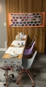 Deluxe Shellac manicure station with hundreds of polish choices
